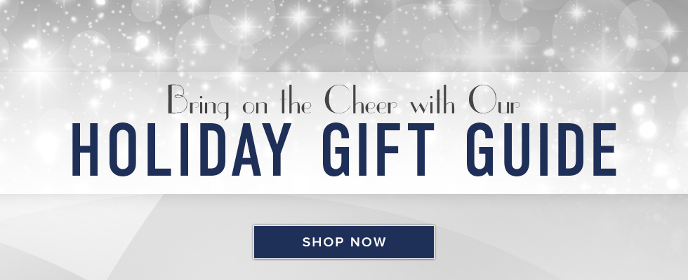 A picture with sparkling lights in the background. Bring on the cheer with our holiday gift guide. Click to shop now.
